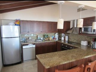 Guests will appreciate the fully equipped kitchen with the granite accents. - Cabo San Lucas villa vacation rental photo