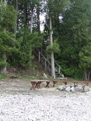 Petoskey cottage photo - Fire pit and stairs up to the cottage