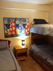 Relax in this second bedroom with brand new full sized bed and twin bunk beds!