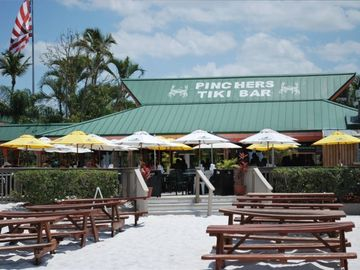 Holiday Inn's Tiki Bar is just a 3-4 minute walk on the sand along beachside