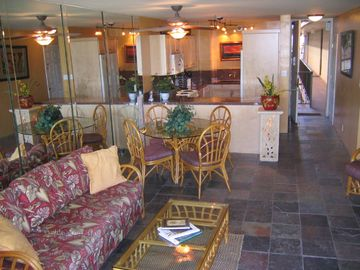 Kihei condo rental - Living area and gorgeous red granite kitchen.