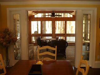 Large screened porch with dining area