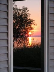 Shelby cottage photo - Sunset Reflecting off a cottage window