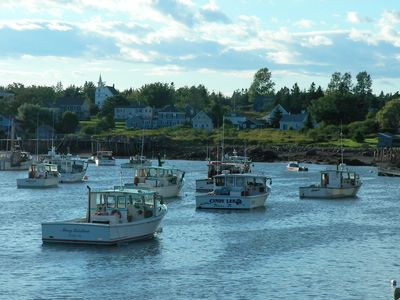 Lobster Boats at rest. House is third to the right of church peeking through.