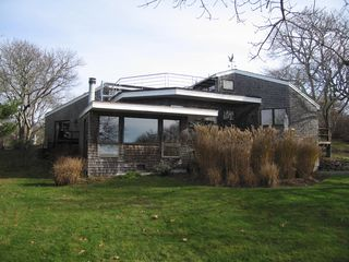Chilmark house photo - View of roof deck and lawn in early spring