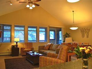 Winter Park condo photo - Spacious living room with vaulted ceiling, and spectacular view of the slopes.