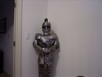 Knight in shining armor standing gaurd upstairs at the top of the steps!
