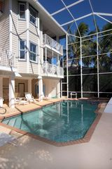 Captiva Island house photo - Heated Pool and Spa with Three Story Cage Screening