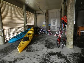 Pensacola Beach house photo - Garage has two kayaks, adult and childrens bikes with helmets and beach toys.