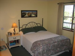 Surfside Beach condo photo - Generous second bedroom with queen bed