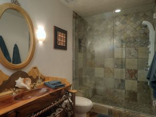 Scottsdale house photo - guest bathroom on main level featuring decadent conch shell sink
