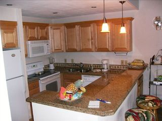 Lahaina condo photo - Remodeled kitchen w/granite bar, coffee maker, toaster, microwave and blender
