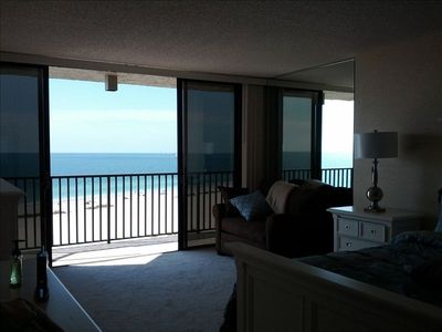 Master bedroom looking across the balcony to the beach and Gulf beyond.
