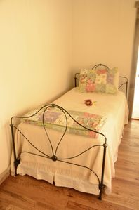 Paonia farmhouse rental - One of the main floor bedroom beds