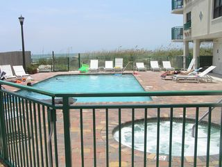 St Pete Beach condo photo - Pool and Jacuzzi overlooking the beach