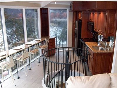 New granite Kitchen with Granite breakfast bar/spiral stairs to lower area/tile