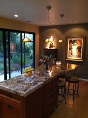 Tiburon house photo - Kitchen opens to garden. Island has seating for five while the chef preps meals.