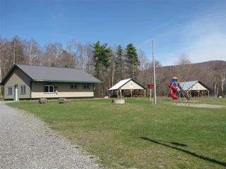 Jay Peak house photo - Playground, snack bar and pavillions at Lake Eden beach.