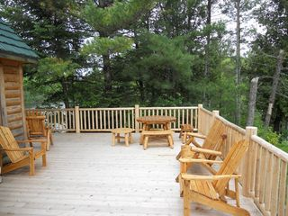 Grayling lodge photo - Side porch overlooking McMasters Bridge.