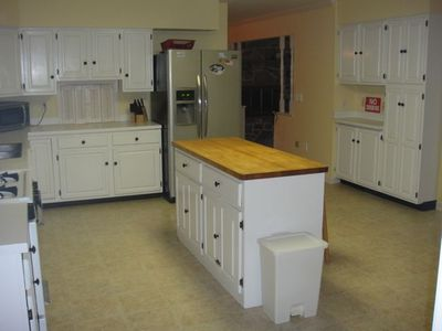 Large kitchen with island and lots of cabinets.