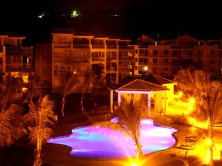 Isabela apartment photo - Night time pool view from terrace