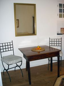 DINING AREA with a four seater gate leg table and a mirror over.