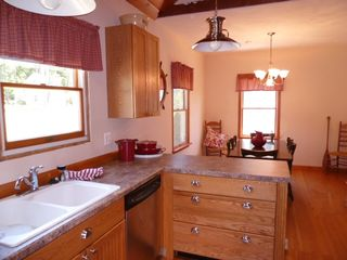 Oneida Lake cottage photo - Custom crafted kitchen has separate dining area.