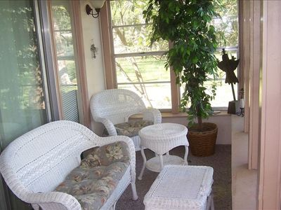 Enclosed porch over looking the Lake