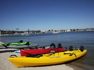 Mission Beach condo photo - Sail Bay in front of the property. Enjoy kayaks, sail boats and paddle boards.