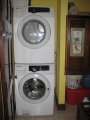 Roatan house photo - Laundry room with modern front loading washer and dryer
