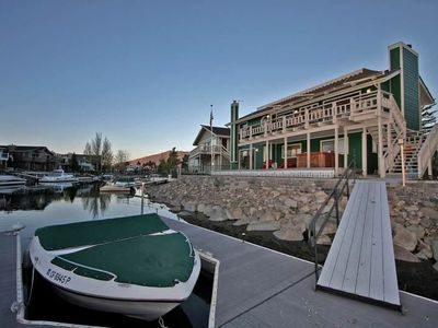 Boat dock for multiple boats, decks overlooking water w/ views of Mt. Tallac