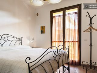 Montopoli Val d'Arno house photo - Comfort on a queen bed with romantic balcony and Tuscan decor!