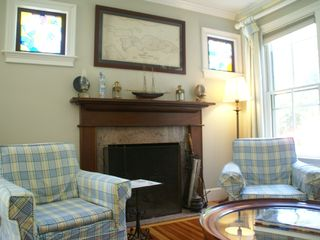 Jamestown (Conanicut Island) house photo - A nautical inspired living room boasts a fireplace