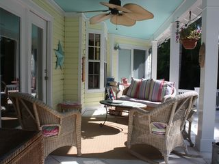 Old Naples house photo - Covered seating with ceiling fan and speakers on upper lanai. Enjoy day or night