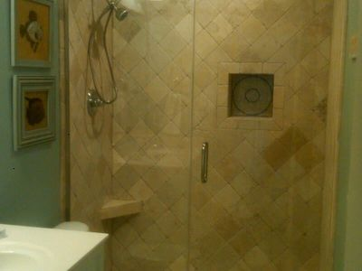 Guest bathroom with walk in tiled shower.