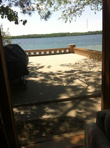 Interlochen cottage rental - Fair photo of resurfaced boathouse deck mid-day