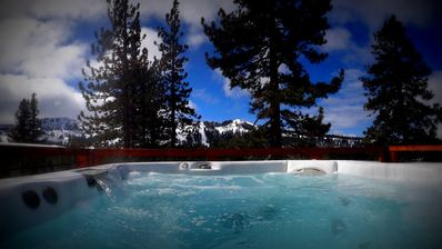 Jacuzzi hot tub on deck with full Sugar Bowl views.