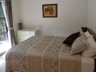 Auckland CBD townhome photo - Downstairs bedroom with brand new queen bed and views to the courtyard.