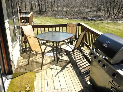 Deck in back. Propane grill and seating for 4 with add'l chairs.