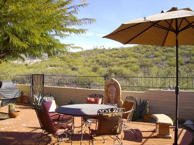 The back patio is a restful place above the heavily vegetated Craycroft Wash.