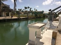 5 Pirates Hideaway - Canal Front Home with Pool and Seawall for your boat
