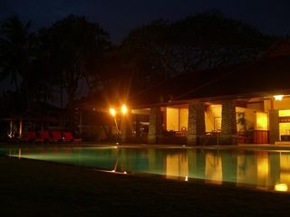 Lahaina condo photo - Tiki torches reflecting on the saltwater pool at night