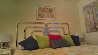 Bedroom with vintage 1970's mod headboard