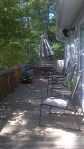 Top floor deck with outdoor dining area and seating to relax in the treetops!