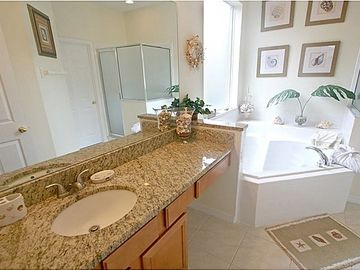Downstairs Master Bathroom with Granite Counter tops