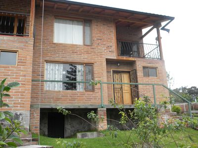 Beautiful two bedroom townhouse in a garden setting with fireplace and balcony.