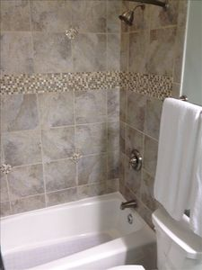 2 Regular Bath tubs & 1 Claw Foot tub, all with new custom tile & new faucets