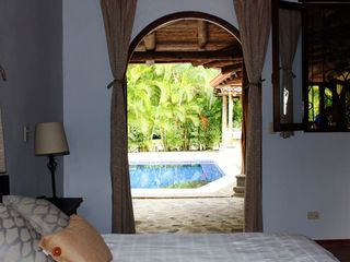 Playa Hermosa house photo - Master bedroom with a view of the private pool. One Queen size bed & dresser