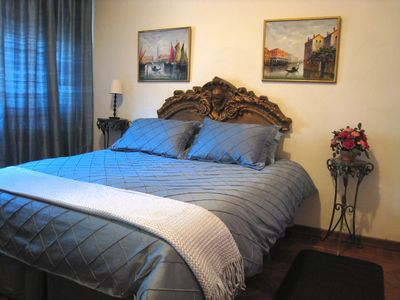 Trastevere area condo rental - The large bedroom has a queen-size bed. There is a clock-radio, a light, and a/c