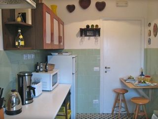 Trastevere area condo photo - There is a fold-up table to give you another seating option for a meal or snack.